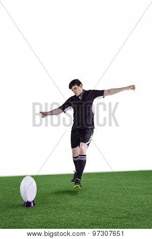 Determined rugby player doing a drop kick