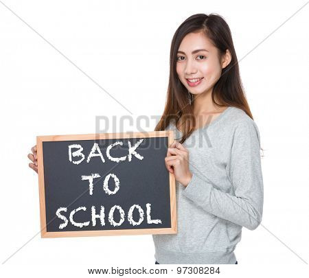 Pretty woman hold with blackboard and showing phrase of back to school