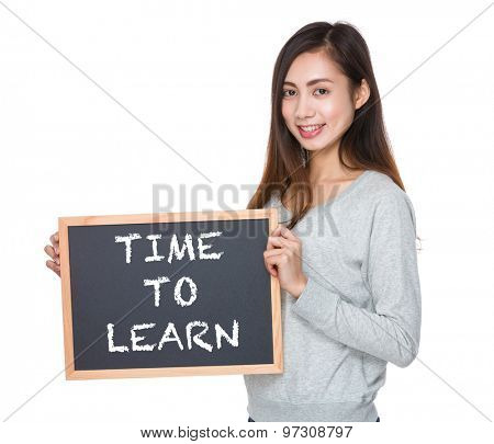 Pretty woman hold with blackboard and showing phrase of time to learn