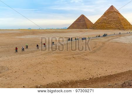 Pyramids Of Giza And Cyclists