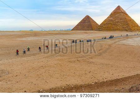 Pyramids Of Giza And Cyclists