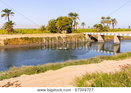 Fisherman On Nile Canal