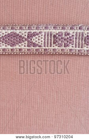 Ethnic Ornament On  Textile Band Above Linen Background