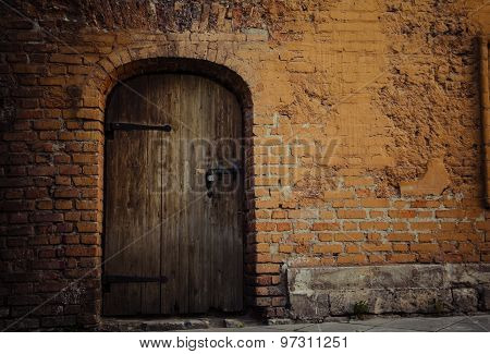 Background: Old Bricks Wall And Rusty Wooden Door