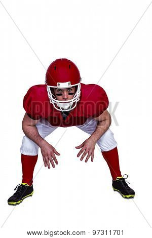 Portrait of an american football player in attack stance
