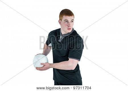 Rugby player about to throw a rugby ball on a white background