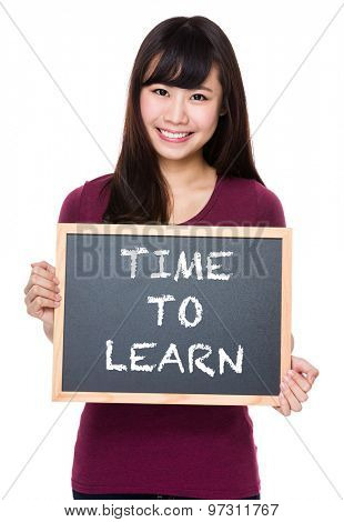 Woman with black board and showing phrase of time to learn