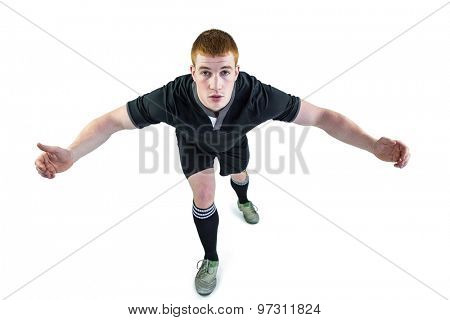 Portrait of a rugby player tackling the opponent