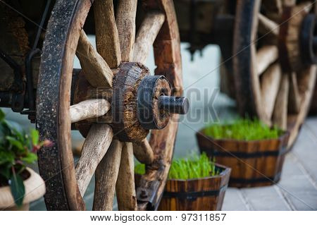 Wheel Of An Old Wooden Cart As A Decorative Element