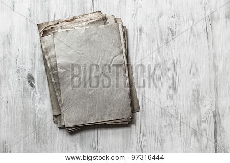 stack of old papers on white wooden background