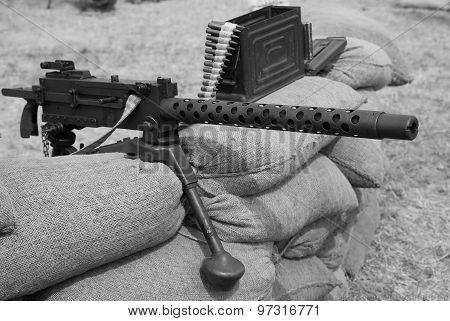 Historic Machine Gun With Bullets Over The Sandbags