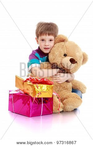 The little boy with a teddy bear