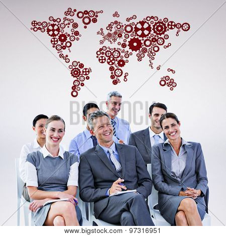 business team during a meeting against grey background