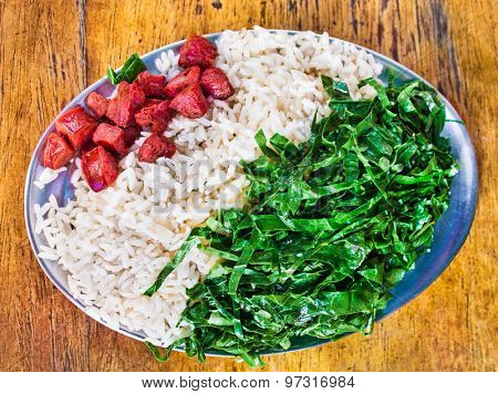 Typical dish of Brazil, rice, spinach and sausages. Rio de Janeiro.