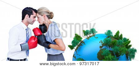 Business people wearing and boxing red gloves against earth with forest