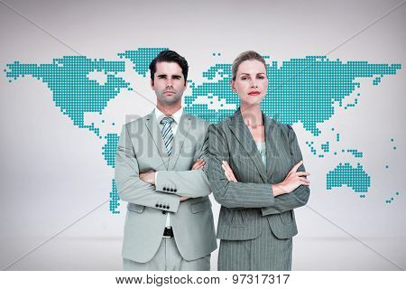 Business people with arms crossed looking at camera against green world map on white background