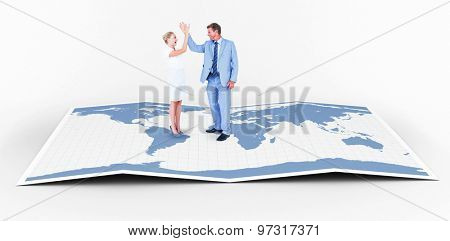 businessman and businesswoman greeting each other against world map