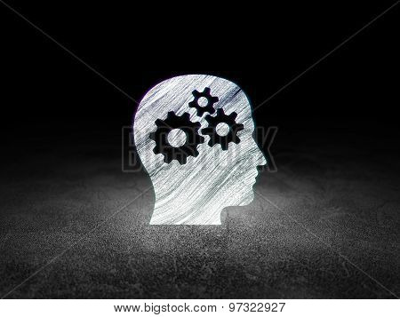 Information concept: Head With Gears in grunge dark room