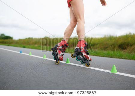 Legs Of Girl Having Roller Skate Exercise