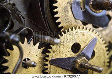Cogwheels Inside Old Clockwork. Macro