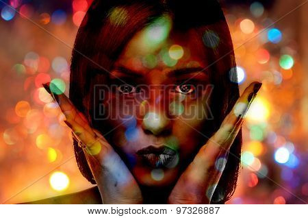 Double exposure photo of a young woman and abstract background with bokeh defocused colorful lights