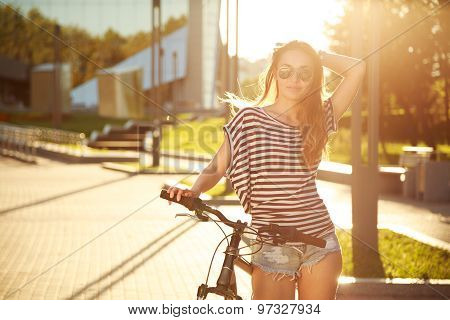 Fashion Hipster Teenager with Bicycle in the City