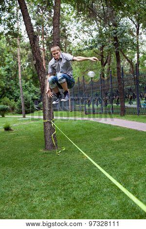 Almaty, Kazakhstan - 04,07,2013: slacklining in the park in the evening