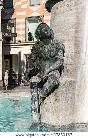 Munich, Germany - June 04, 2015: Marienplatz also called Mary's Square is one of the most vital places in Munich with the Fischbrunnen fountain and the sculptures