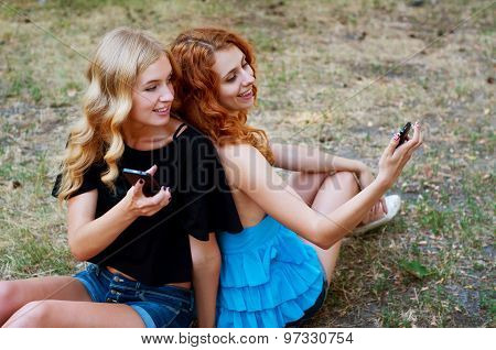 Two Girlfriends Taking A Selfie