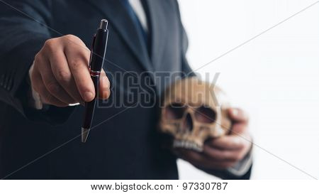 Businessman With Pen And Skull