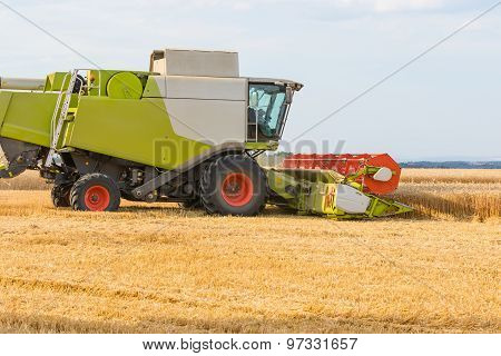 Combine Harvesting Golden Wheat