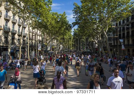 Barcelona, Spain- July 25: Famous Street La Rambla In Barcelona, Spain. Thousands Of People Walk Dai