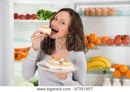 Woman Eating Slice Of Cake