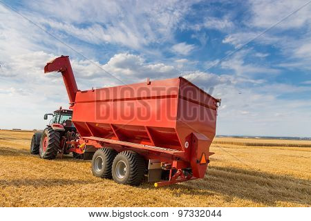 Agricultural Tractor And Harvesting Trailer