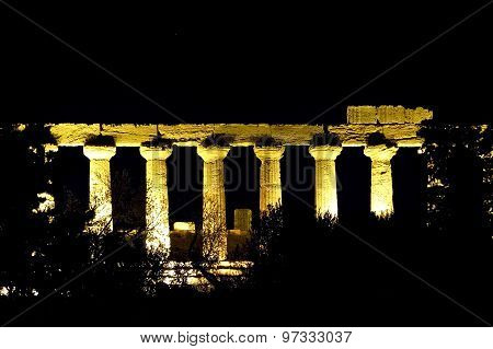 The columns of a greek temple in Agrigento during the night