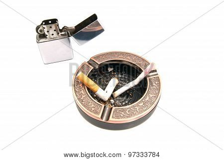 Butts In Ashtray And Lighter On White