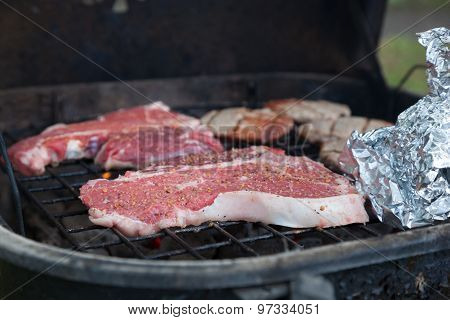 T-bone Steaks On Charcoal Grill