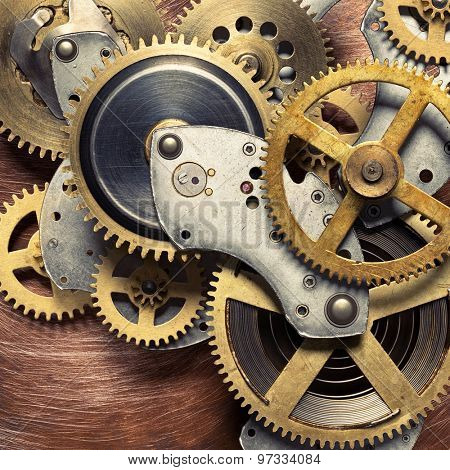 Metal collage of clockwork gears on copper background