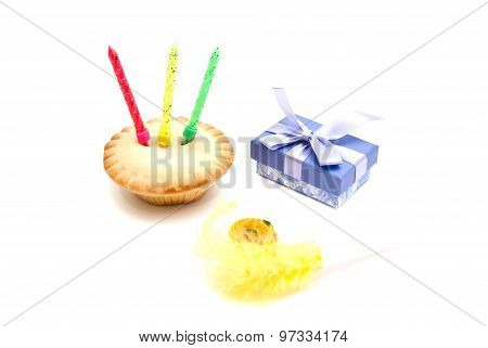Cupcake With Three Birthday Candles, Gift And Whistle On White