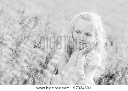 Portrait Smiling Toddler Girl In Lavender