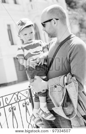 Father Holding His Son Toddler Walking