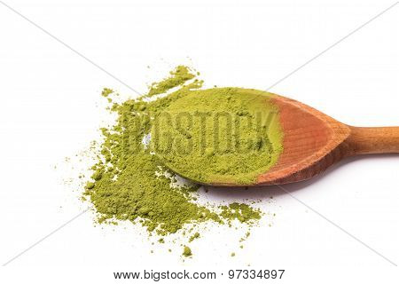 Matcha Tea In A Wooden Spoon On White Background