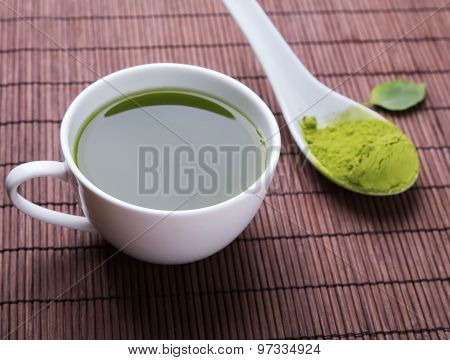 Matcha Tea In A White Cup On The Mat