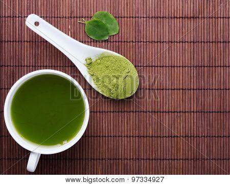 Matcha Tea On The Brown Mat