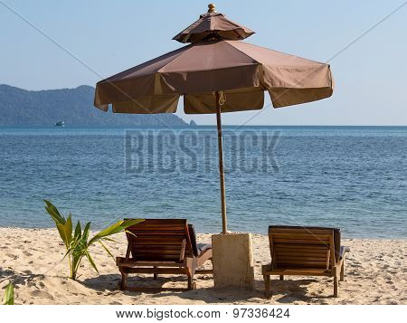 Beach Chair And Umbrella On The Beach In Sunny Day , Thailand
