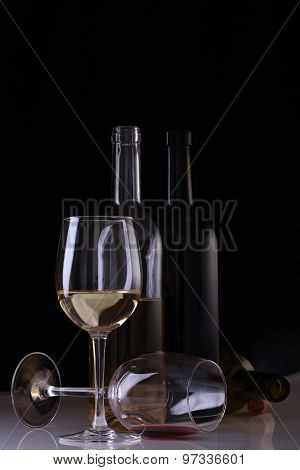 Bottles And Glasses With Wine