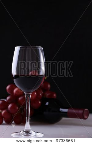 Glass Of Wine Grapes And Bottle