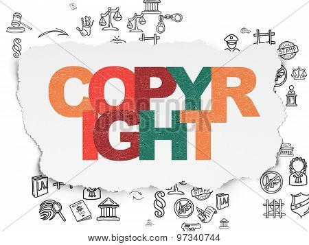 Law concept: Copyright on Torn Paper background