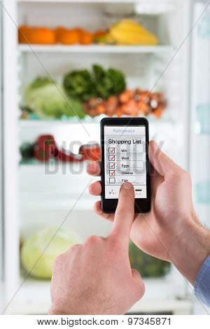 Person Hands Making Shopping List On Mobile Phone