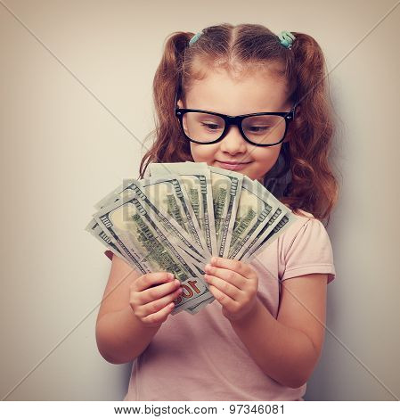 Happy Kid Girl In Glasses Looking On Money And Counting The Profit. Vintage Portrait